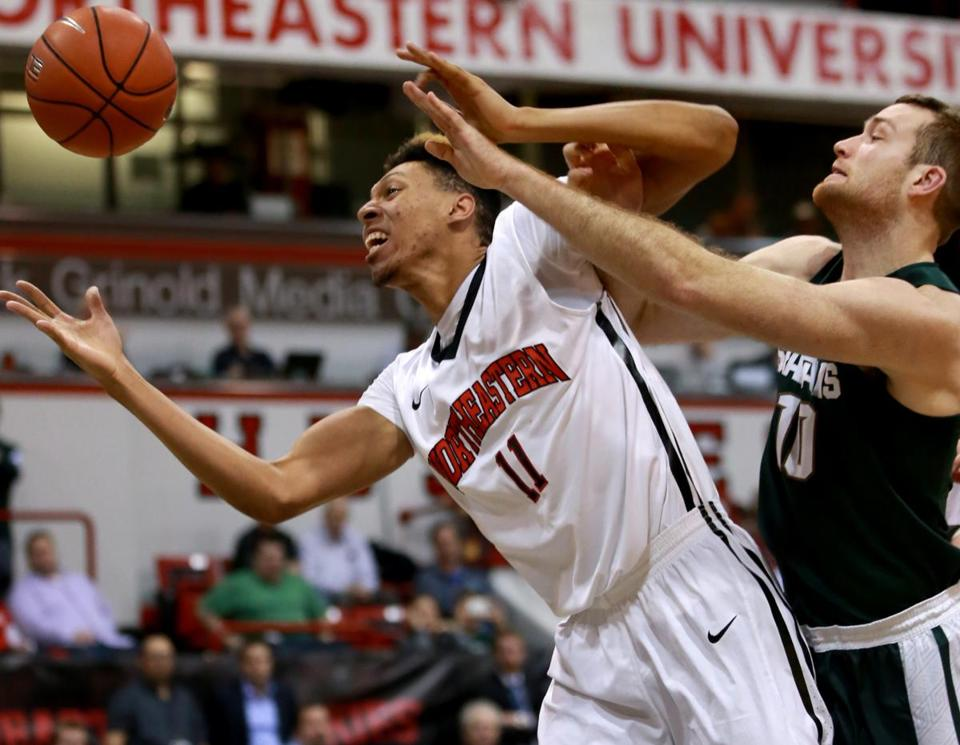 Jeremy Miller helped spark the Huskies on Thursday, with 11 points off the bench. (Image Courtesy of The Boston Globe)